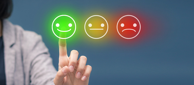 Woman pressing happy smiley face emoticon on virtual touch screen. Customer service evaluation concept.